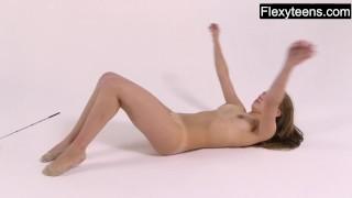 Young Kira does naked gymnastics